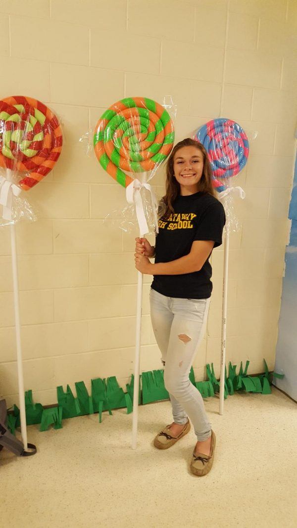 Senior Caitlyn Erdman shows off her 'lollipops' she created out of pool noodles, duct tape, and pvc pipe.