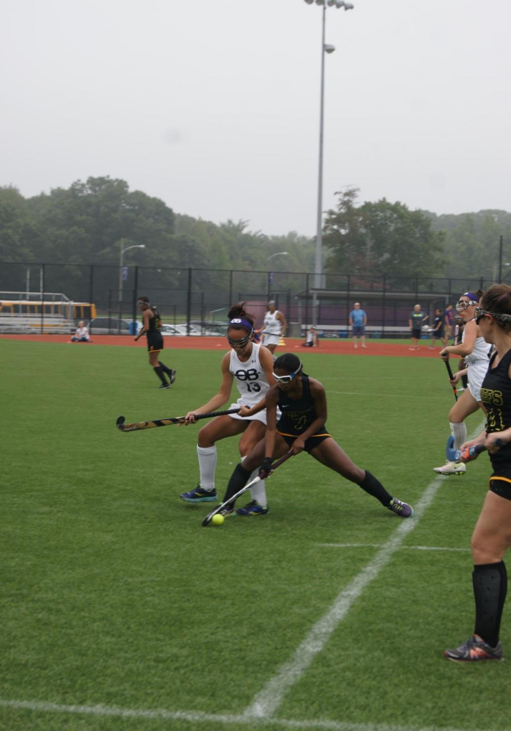 Dominique Nelson uses her defensive skills to get the ball away from her opponent.