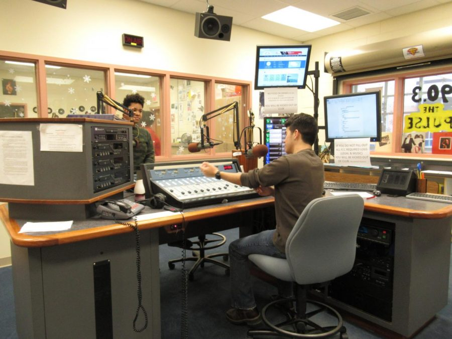 Students Robby Armas and Simone Wolfskehl working together at the station