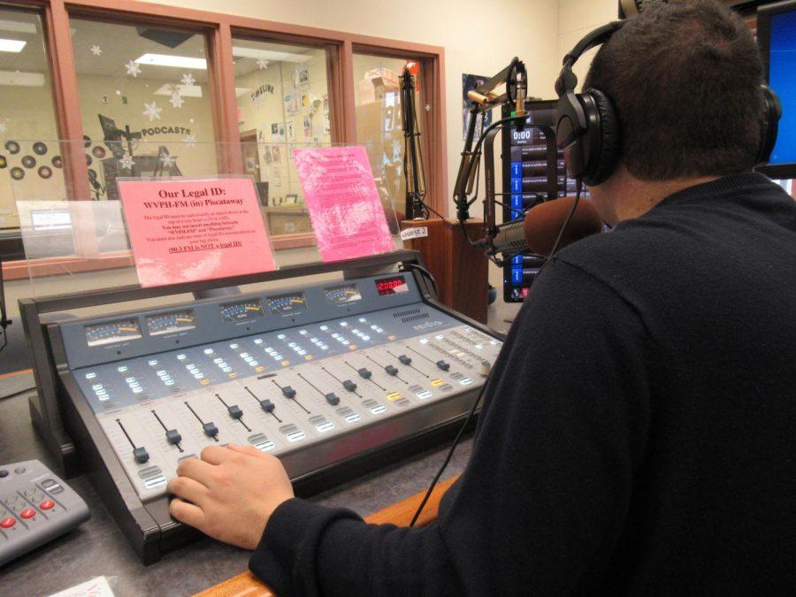 Mr. Giannino working at the music station