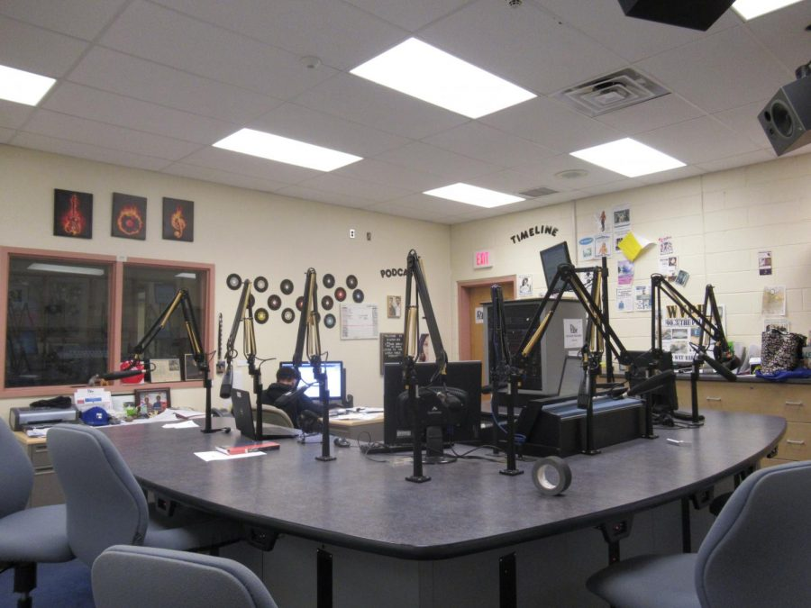 A full view of the first recording room, including the equipment and decor that hang upon the walls