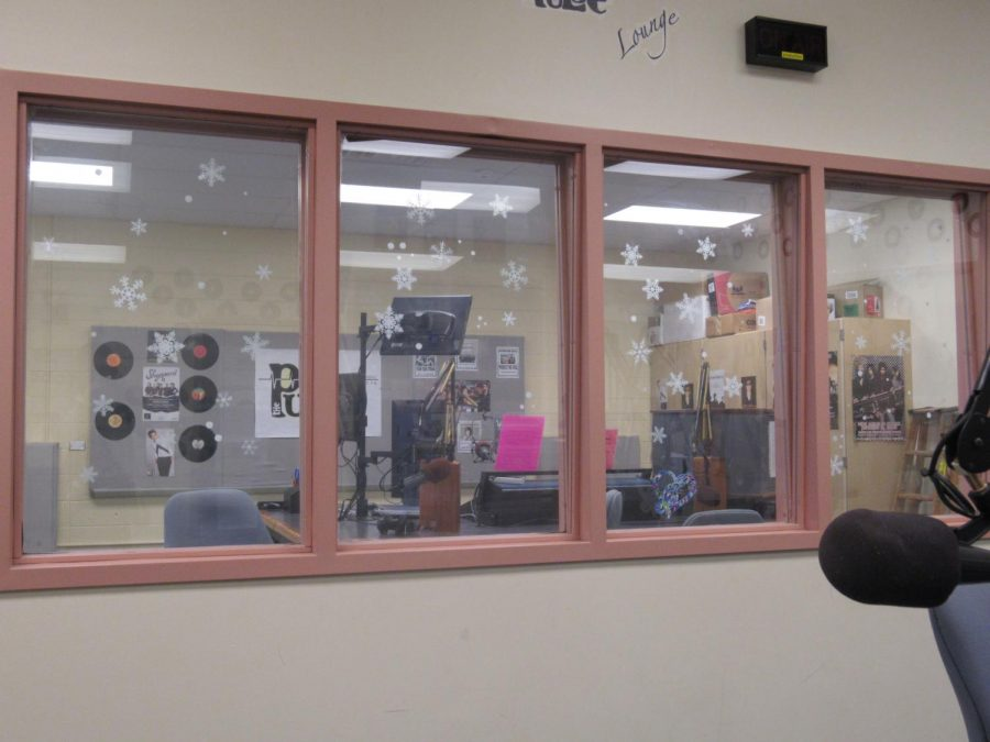 Looking through the window in the main room that leads into the second recording area with state of the  art equipment