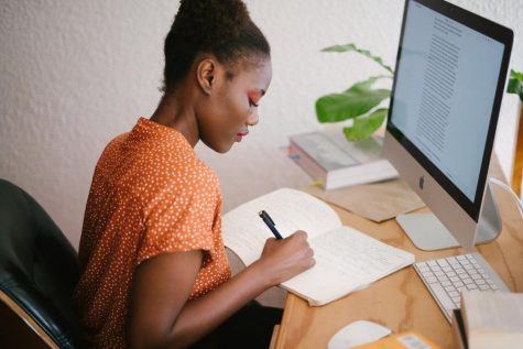 The girl in this picture is efficiently studying from home in an organized workspace.  Photo credit: Pexels