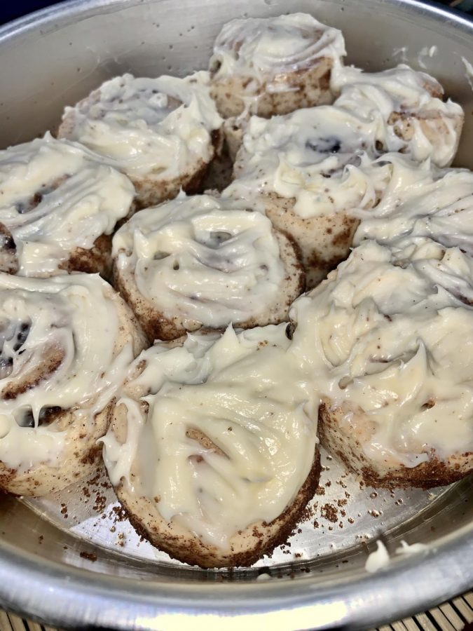 Let the cinnamon rolls cool completely before frosting and serving. Spread the frosting evenly over each roll.