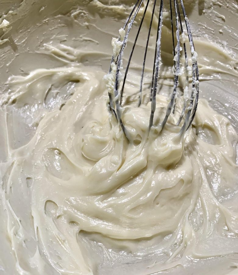 Make the frosting while the rolls are baking. Combine the cream cheese and butter in a large mixing bowl. Beat the ingredients until smooth then add the vanilla until it is just combined. Add the confectioners sugar and beat just until combined.