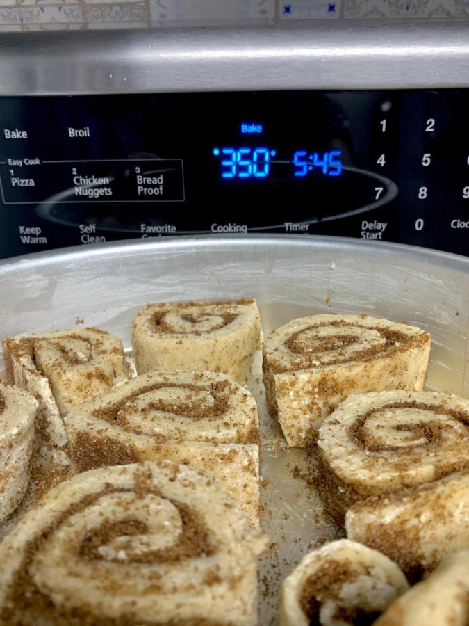 Arrange all the cinnamon rolls in a pan greased with butter. You can even add the extra trimmed off pieces (to not waste anything). Bake the rolls for 25 to 30 minutes until they are pale golden and baked through.