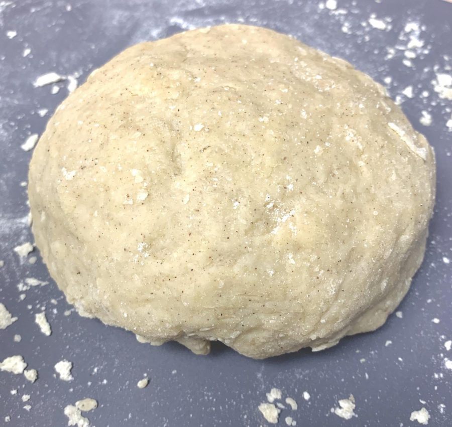 Knead the dough until it comes together in a smooth ball. If it feels too sticky, add more flour as needed. Be careful not to over-knead the dough.
